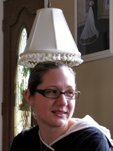 Why is Jen wearing a lampshade on her head???? must have been a good party...