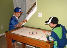 Air Hockey tournament in the basement